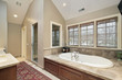 Master bath with wood paneled tub