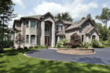 Luxury home with arched entry