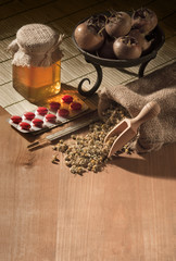still life with natural medicines and thermometer