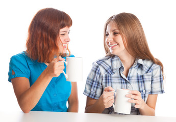 girls are drinking from the cups