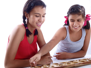 girls playing mancala
