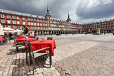 Fototapety Cafe tables with red tableclothes in Plaza Mayor. Madrid.