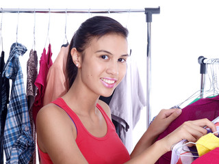 smiling girl looking for clothes