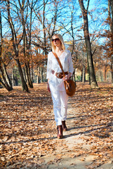 Beautiful  woman walking in the autumn colored park