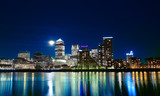 Canary wharf across the Thames at night