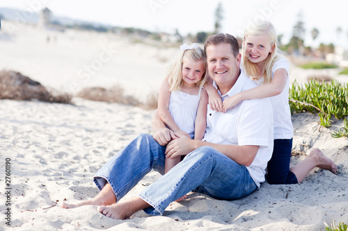 Handsome Dad and His Cute Daughters at The Beach