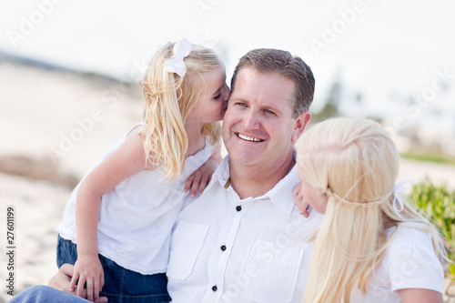 Handsome Dad Getting Kisses from His Cute Daughters