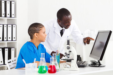 two african scientists working in lab