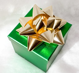 metallic green gift box with gold bow