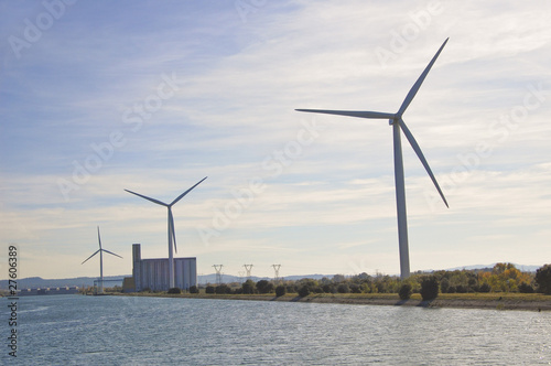 Wind turbines generate electricity along the Rhone river