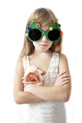 Little girl wearing big round glasses making silly expression