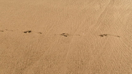 Leaving footprint in the sand - HD
