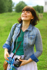Young attractive woman with a camera