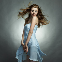 Fashion portrait of the young dancing woman