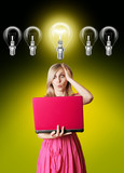 blonde in pink dress with laptop and bulb