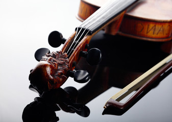 Violin and bow on dark background