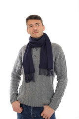 Young handsome possitive man in warm winter casual clothes think