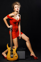 Extravagant model with electric guitar and amplifier