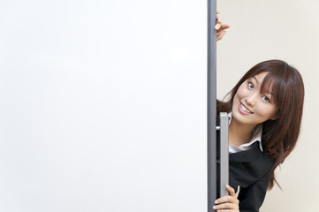 a portrait of young business woman with blank white board