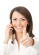 Happy businesswoman with cell phone and thumbs up, isolated