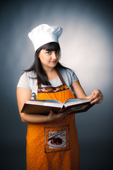 woman cook holding a recipes book