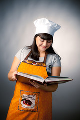 woman cook reading recipes