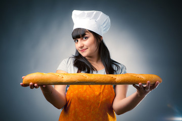 woman cook holding french bread