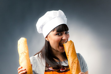 woman cook tasting a french bread