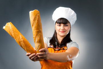 woman cook holding french bread, focus on the bread