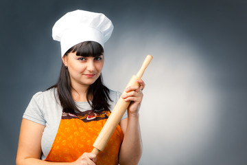 woman cook holding a rolling pin