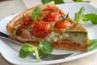 Tomato, basil and pesto gruyere on a plate