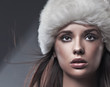 Portrait of a young beauty wearing winter hat