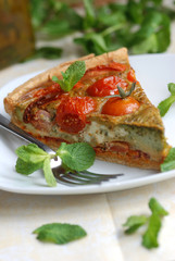 Tomato, basil and pesto gruyere on a plate