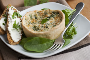 Spinach quiche with watercress and toast