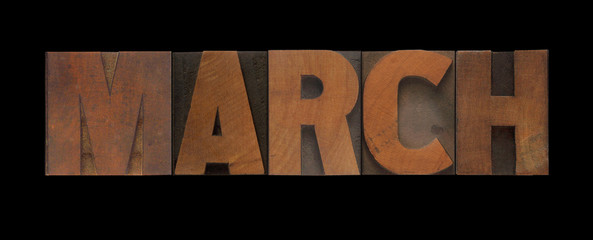the word March in old letterpress wood type
