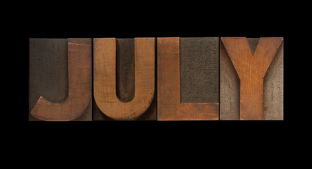 the word July in old letterpress wood type