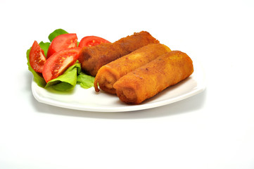 Polish Cuisine. Croquette and tomato on white plate.
