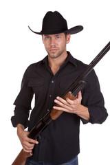 holding rifle man