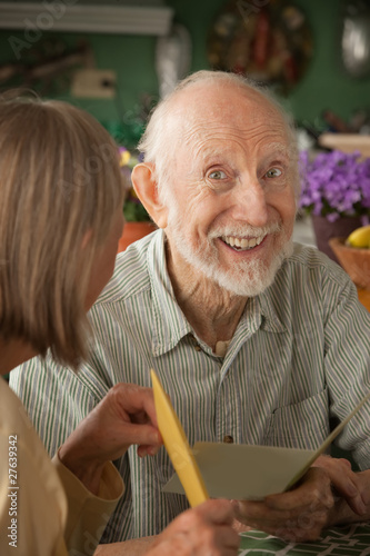 Senior man with greeting card