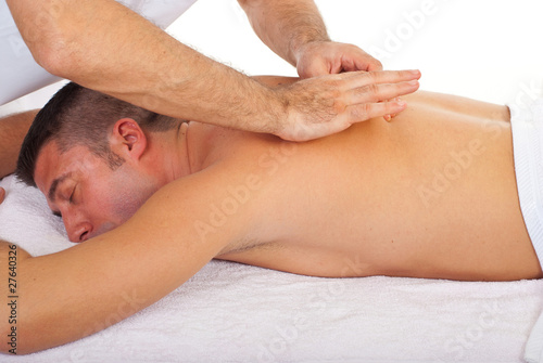 Man receiving back massage