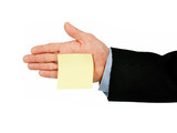 yellow post it note on hand