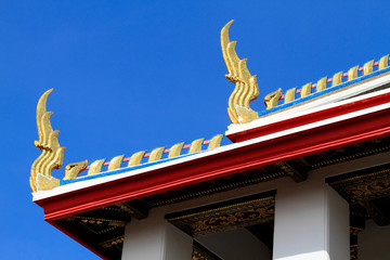 golden naga on roof  temple