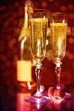 Elegant champagne glasses and bottle