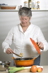 Women is cooking food in a orange pan