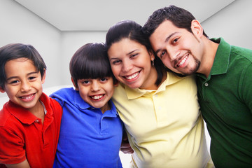 Family embracing in multi-color shirts