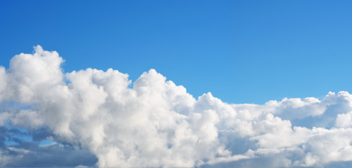 Blue sky puffy cloud