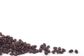 dark roasted fair trade coffee beans isolated on white