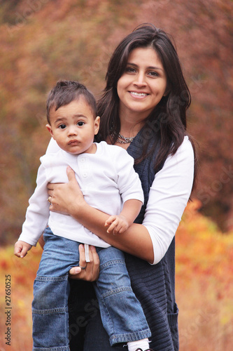 Autumn portrait of mom holding toddler child