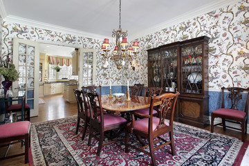 Dining room with floral wallpaper