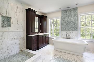 Master bath with white tub